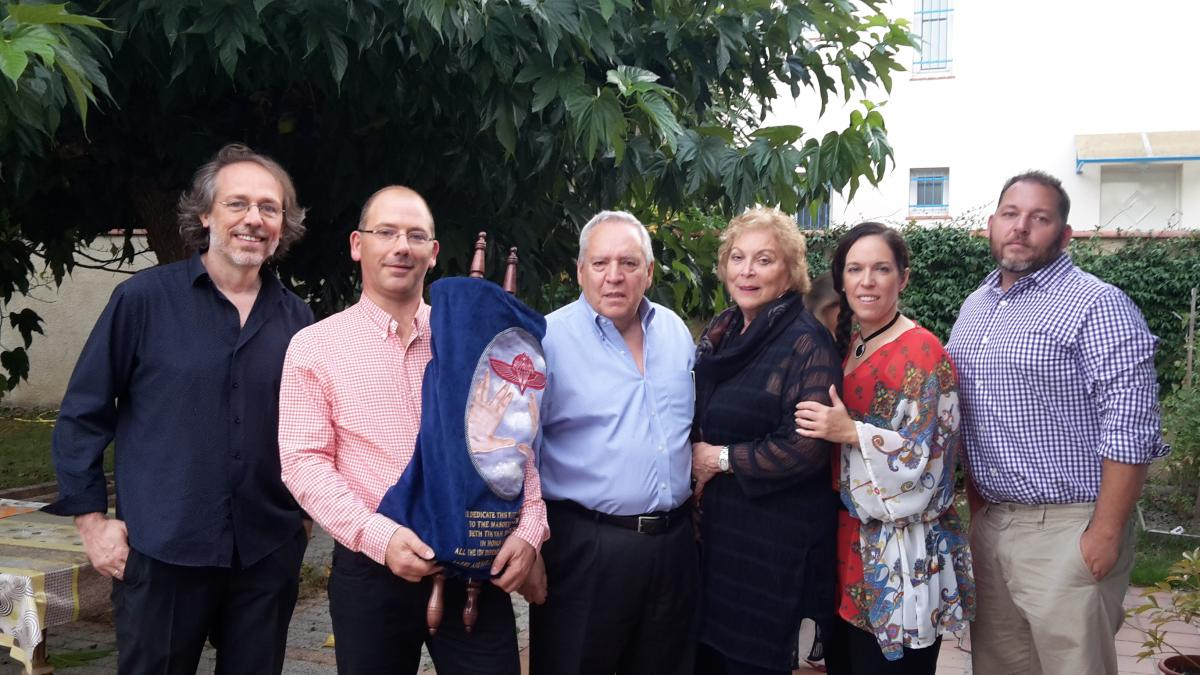 Larry Ritter and family delivering a Torah to Beth Tikvah, Toulouse